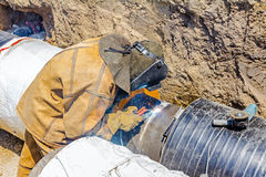 Metalworker working on a pipeline Stock Photo