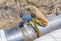 Metalworker working on a pipeline Stock Photos