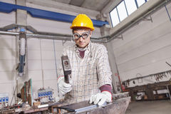Metalworker works metal with hammer on the anvil Stock Image