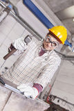 Metalworker works metal with hammer on the anvil Royalty Free Stock Image