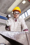 Metalworker works metal with hammer on the anvil Stock Photos