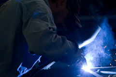 Metalworker in a workshop Stock Image