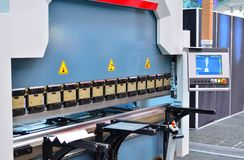 Metalworking bending machine for sheet metal blanks royalty free stock photos