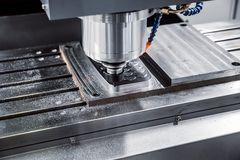Metalworking CNC milling machine. Cutting metal modern processing technology. stock photo