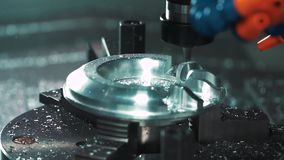 Metalworking CNC milling machine. Cutting metal modern processing technology. Small depth of field. slow motion