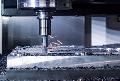 Metalworking CNC milling machine. Cutting metal modern processin Stock Photos