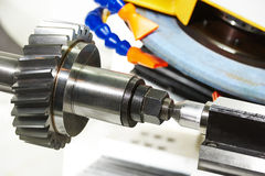 Metalworking cogwheel gear polishing process Royalty Free Stock Photo