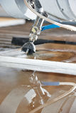 Metalworking  cutting with water jet Royalty Free Stock Images