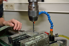 Metalworking with drill Royalty Free Stock Images