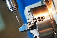 Metalworking drilling process on cnc machine Stock Images