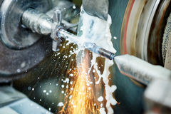 Metalworking industry. finishing metal surface on grinder machine Stock Images
