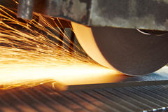 Metalworking industry. finishing metal surface on horizontal grinder machine Royalty Free Stock Photo