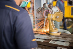 Metalworking industry: finishing metal working on lathe grinder machine Royalty Free Stock Photo