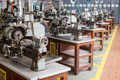 Metalworking industry: finishing metal working on lathe grinder machine. With flying sparks Stock Photography
