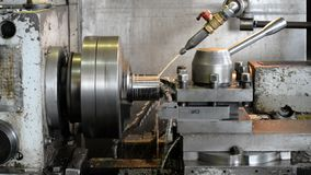 Drilling a deep hole of large diameter. When drilling, a lubricating-cooling liquid is supplied. Metalworking on a lathe. Drilling a deep hole of large diameter stock video footage