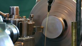 Metalworking Lathe. Processing of metal parts on the lathe machine stock video footage