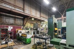 Metalworking shop. Guillotine shears, grinding machines. Metalworking shop. Guillotine shears, grinding and lathes Royalty Free Stock Photos