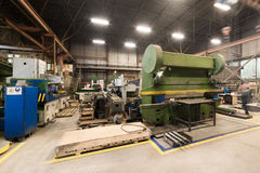 Metalworking shop. Guillotine shears, grinding machines. Metalworking shop. Guillotine shears, grinding and lathes Stock Photography