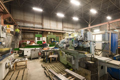 Metalworking shop. Guillotine shears, grinding machines. Metalworking shop. Guillotine shears, grinding and lathes Stock Photos
