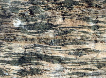 Metamorphic layered rock. Layered black and white metamorphic rock Royalty Free Stock Photos