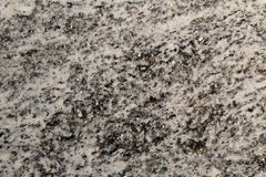 Metamorphic rock used as decorative stone with shiny minerals Stock Photos