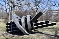 Metamorphosis. This is an early Spring picture of a piece of public art titled: Metamorphosis, on display at the Skokie Northshore Sculpture Park located in stock photo