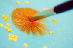 Metaphor of brush painting stars Royalty Free Stock Photos