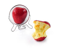 Metaphor for eating disorder. Fat and slim apple in mirror - metaphor for eating disorder Stock Image