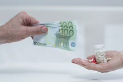 Metaphor of expensive medicine. Horizontal view of metaphor of expensive medicine Royalty Free Stock Photos