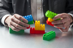 Metaphor for real estate or architecture with focus on hands Royalty Free Stock Photos