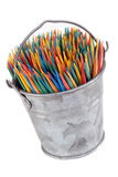 Metaphor take your pick multiple color toothpicks. Metaphor take your pick of multiple color toothpicks in a small tin bucket on white background Royalty Free Stock Images