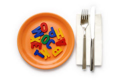 Metaphoric ''Food for thought''. Tableware set and alphabetic letters as the food for the mind royalty free stock images