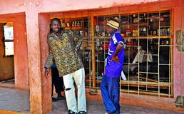 Metarica Shop - Niassa Mozambique. Two men stand outside a brick under tin roof shop. This is one of the more permanent structures by way of shops in Metarica Stock Images
