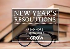 Metas de la resolución del Año Nuevo contra los libros y las gafas Imagen de archivo libre de regalías