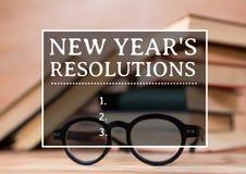 Metas de la resolución del Año Nuevo contra los libros y las gafas Fotos de archivo libres de regalías