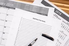 2018 metas del Año Nuevo con el calendario Fotografía de archivo libre de regalías