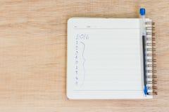 Metas para 2016 - lista de control en la libreta con la pluma Fotografía de archivo