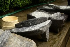 Metate, metlatl or mealing stone for corn in Mexico Royalty Free Stock Image