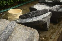 Metate, metlatl oder mealing Stein für Mais in Mexiko Stockfotografie