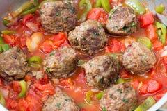 Metballs cooking in sauce Stock Photos