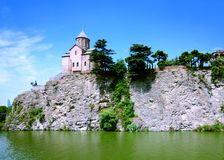 The Metekhi Church on a cliff above the Kura river in Tbilisi. royalty free stock image