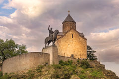 Metekhi church and monument of King Vakhtang Gorgasali in Tbilisi, Georgia. Metekhi church and the equestrian statue of King Vakhtang Gorgasali in Tbilisi Stock Photos