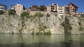 Metekhi church of Tbilisi in the rock above the river Kura stock video footage