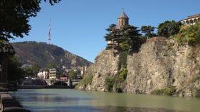 Metekhi church of Tbilisi in the rock above the river Kura stock video