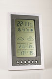 Meteo station close up. Home environment sensor showing temperature, humidity, time and weather forecast Stock Image