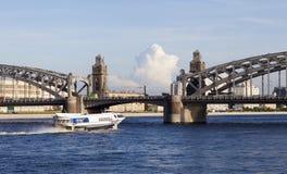 Meteor (boat) on the Neva River, against the background Bridge of Peter the Great (Bolsheokhtinsky). Saint Petersburg. Royalty Free Stock Image