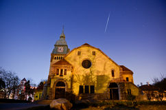 The meteor through the church sky Royalty Free Stock Photo