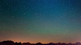 Meteor explosion, meteor shower and stardust smoke trail in night sky, time lapse of the Milky Way and the starry sky over the Alp stock footage
