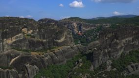 Meteora Beautiful Stone shapes and Mountains with Monastery on them stock video footage