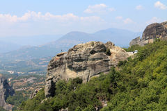 Meteora Greece Europe. View of the the abyss, huge rock and the people on top Royalty Free Stock Photo